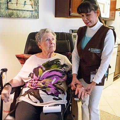 Caretaker taking patient vitals