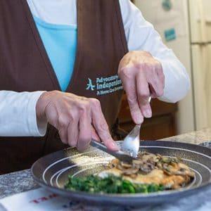 Caretaker cooking meal