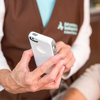 Caretaker using mobile phone